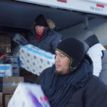 Members of the Oklahoma Indian Missionary Conference, including the Rev. David Wilson (left, in truck) and Justin Phillips, deliver supplies to water protectors at the Standing Rock Sioux base camp near Cannon Ball, N.D.